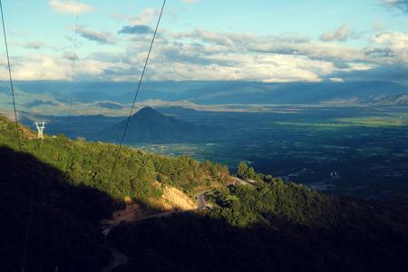 dalat: Amazing landscape of Ngoan Muc mountain pass, a dangerous road link Phan Rang with Dalat of Vietnam, beautiful scene with mountain terrain among forest in evening