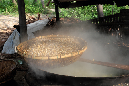 sift: process mussel, cook seafood in boil water then sift mussel pulp from sell, mussel is famous food in Hoian, Vietnam Stock Photo