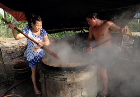 boil water: HOI AN, VIET NAM- FEB 17, 2016: Vietnamese people process mussel, they cook seafood in boil water by firewood, mussel in famous food in Hoian, Vietnam