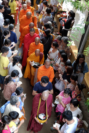 cassock: HO CHI MINH CITY, VIET NAM- MAY 21, 2016: Religion activity at Buddhist temple on Buddhas birthday celebration, group of Asia monks walk to beg for alms, traditional culture of Buddhism, Vietnam Editorial