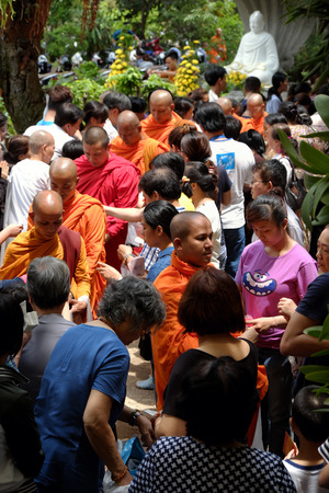 birthday religious: HO CHI MINH CITY, VIET NAM- MAY 21, 2016: Religion activity at Buddhist temple on Buddhas birthday celebration, group of Asia monks walk to beg for alms, traditional culture of Buddhism, Vietnam Editorial