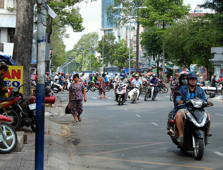 circulate: HO CHI MINH CITY, VIET NAM- MAY 30, 2016: Chaotic traffic and take pavement at Asia city, this make walker have to walk on roadway with high accident risk, street with crowd vehicle as motorbike Editorial