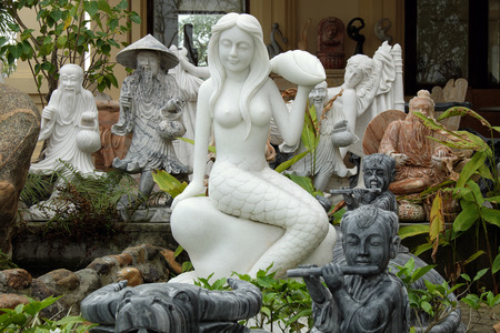 craft on marble: Sculpture art at Ngu Hanh Son, group of amazing shape for feng shui make from stone, statue product in white rock for religion