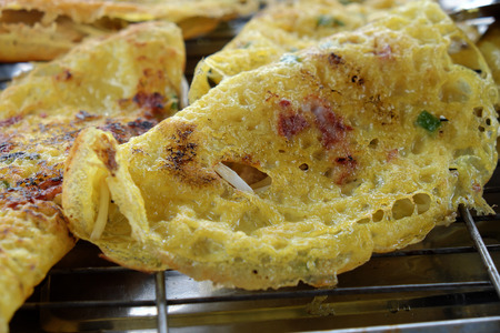 Vietnam food, banh xeo or vietnamese pancake make from rice flour and filled with a shrimp, meat, soya bean sprouts, is popular Viet Nam street food