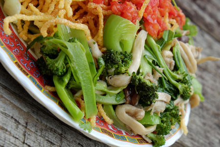 vietnamese food: Vietnamese food, vegetarian eating from noodle with vegetable, meal for diet, rich fiber, colorful on plate with tomato, cabbage, mushroom, cauliflower