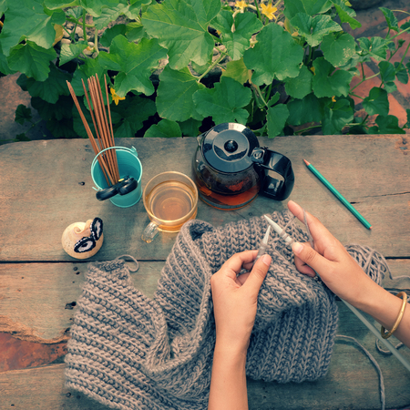 cold day: Knit man scarf for cold day in winter, hobby leisure with handmade gift for father day, woman hand knitting from yarn, nice present in vintage color