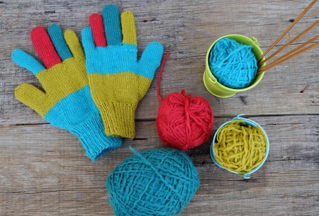 cold day: Abstract accessory for cold day in winter, colorful gloves make from leisure hobby in free time, handmade gift for mother day or valentine day