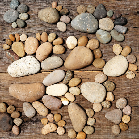 pebblestone: Abstract cute concept on wood background from pebbles, amazing arranged boulder to family of footprint, awesome shape from pebblestone