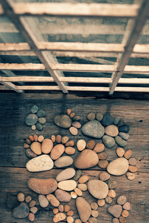 pebblestone: Abstract cute concept on wood backgroup from pebbles, amazing arranged boulder to family of footprint, awesome shape from pebblestone Stock Photo