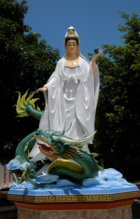 hung: BAC LIEU, VIET NAM- JULY 15, 2016: Buddha statue at Hung Thien pagoda, Mekong Delta, a place for religion travel, amazing scene with big statue of Bodhisattva at Buddhist temple, Vietnam Editorial