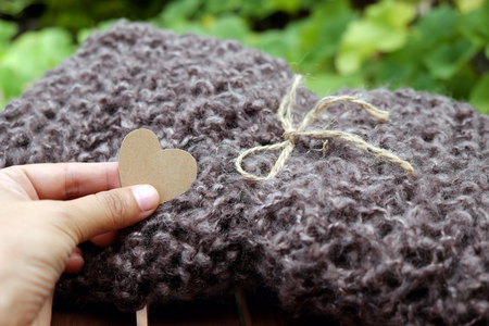 Handmade gift for mother on Xmas holiday, knitted scarf from brown yarn can make warm in cold weather at Christmas season Stock Photo