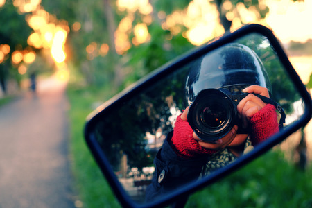female photographer: Female photographer enjoy life when travel and take photo at Vietnam countryside, a backpacking journey by motorcycle to adventure Vietnam scene, women hand shooting relfect on mirror of motorbike