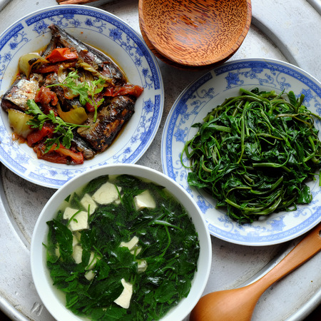 vietnamese food: Vietnamese food, fish sauce, boiled vegetable and vegetables soup.Dinner time is family meal and happy time, a traditional culture Stock Photo