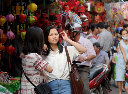 HO CHI MINH CITY, VIET NAM- SEPT 13, 2016: Group of Vietnamese visit lantern street to buy lanterns for mid autumn festival when full moon, a traditional culture for children in Vietnam