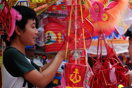 HO CHI MINH CITY, VIET NAM- SEPT 13, 2016: Vietnamese visit lantern street to buy lanterns for mid autumn festival when full moon, a traditional culture for children in Vietnam