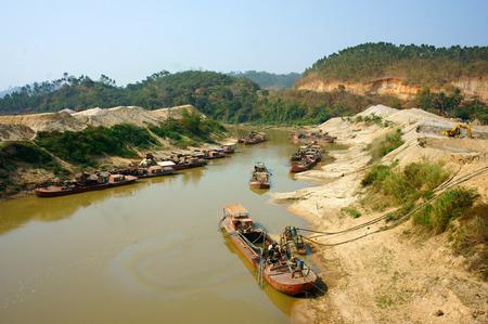 sabotage: DAK LAK, VIET NAM- FEB 8, 2014: Group of boat exploit sand on river, sands explotation make change flow and environment, Daklak, Vietnam