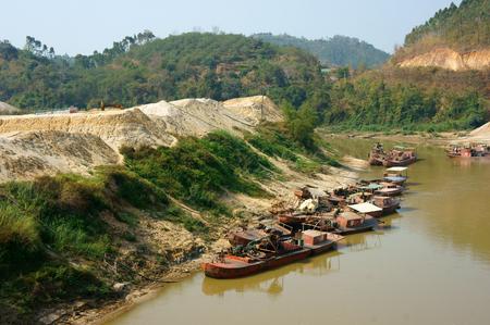DAK LAK, VIET NAM- FEB 8, 2014: Group of boat exploit sand on river, sands explotation make change flow and environment, Daklak, Vietnam