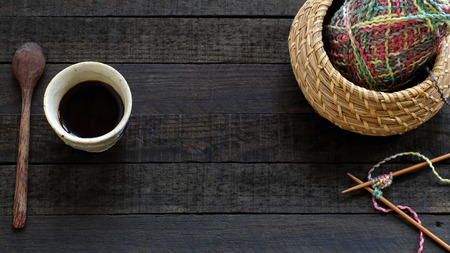 leisure activities: Knitted background with knitting needle, yarn and coffee cup, knit is hobby, leisure activities of many people in free time, also make many handmade product