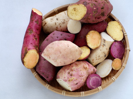 Diversity sweet potato on white background, healthy food that rich fiber, vitamin, starch and mineral, this cereal absorb toxin, fat so good for digestive system Stock Photo