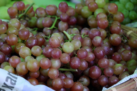 Basket of grape at Vietnam marketplace, fresh fruit, organic agriculture product, good for health, rich vitamin c