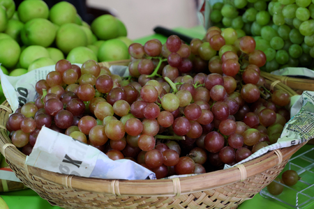 vitamin rich: Basket of grape at Vietnam marketplace, fresh fruit, organic agriculture product, good for health, rich vitamin c