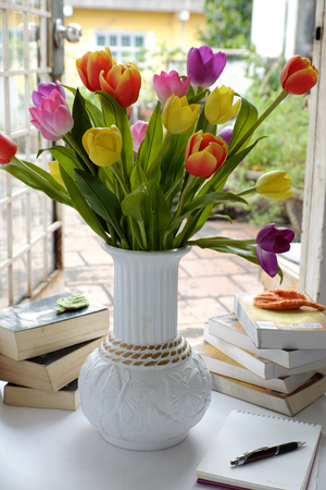 special education: Happy teachers day with handmade tulip flower pot, stack of books, pen, message for teacher in special day of education, tulip bouquet diy from clay material Stock Photo