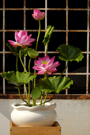 Artificial flower, handmade lotus flower with green leaf and pink petal make from clay, diy art product for home decoration