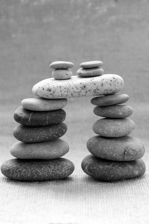Amazing arrangement to make tower from pebble, two stack of stones and more boulder to illustration for bond in family relationship or burden of debt