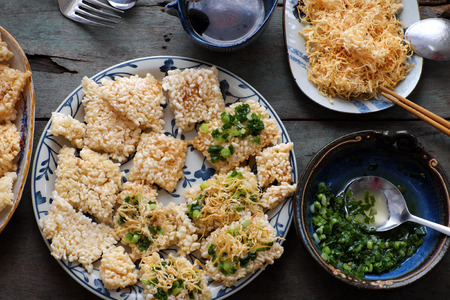 Vietnamese street food, fried dried rice with pork floss, with popular name is com chay cha bong, a tasty snack food, woman hand process at home to ensure food safety Stock Photo