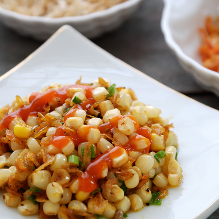 scallions: Vietnamese street food, corn fried dried shrimp, is popular snack food make from corn fry with shrimp, butter, scallions, eat with chilli sauce