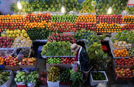Colorful of fruit shop at Dalat marketplace, Vietnam, many kind of fresh tropical fruits arrange so amazing, agriculture product at farmer market