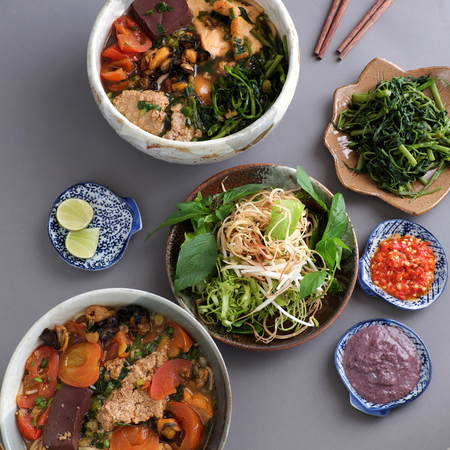 Vietnamese food, bun rieu and canh bun, is popular street food cook from crab, tofu, vermicelli eat with shrimp paste, vegetables, is delicious and cheap dish