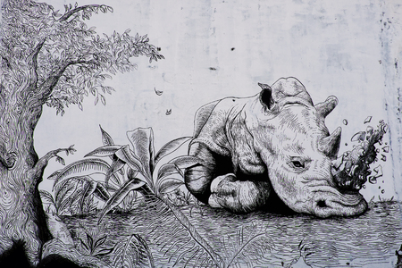 craftmanship: HO CHI MINH CITY, VIET NAM- MARCH 23, 2017: Propaganda campaign to Vietnamese dont use Rhino horn by graffiti art, Rhinoceros painting on wall, message people protect animal, meaningful street art