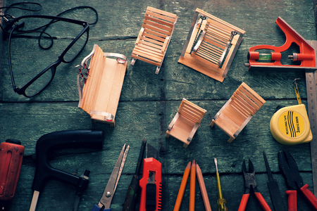 self made: Diy tools background with group of crafting tools like scissors, hammer, knife, equipment for handmade product on wood background, a hobby of dad to repair in home Stock Photo