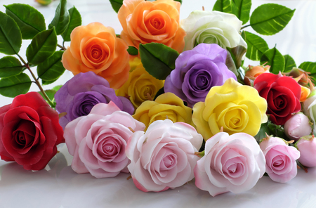 Wonderful clay art with colorful roses flower on white background, beautiful artificial flowers of craftsmanship with skillful  Stock Photo