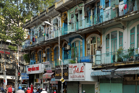 HO CHI MINH CITY, VIET NAM- APRIL 18, 2017: Scene of old apartment building at Cho Lon on day, amazing ancient architecture of China town, Vietnam Editorial