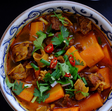 Vietnam food, bread with stewed beef, a popular meal at morning, eat attach parsley, basil, lemon pepper and salt make so delicious taste Archivio Fotografico