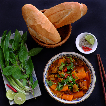 Vietnam food, bread with stewed beef, a popular meal at morning, eat attach parsley, basil, lemon pepper and salt make so delicious taste 版權商用圖片