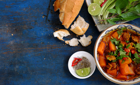 bo: Vietnam food, bread with stewed beef, a popular meal at morning, eat attach parsley, basil, lemon pepper and salt make so delicious taste Stock Photo