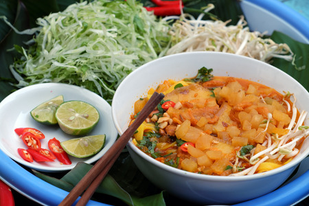 Homemade Vietnam food, Mi Quang Dalat, a kind of noodle soup with raw material as yellow noodle, dried shrimp, pork, vegetable from colorful ingredient