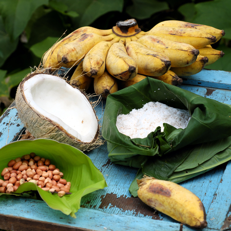 Homemade Vietnam sweet food for dessert, banana cream, raw material to make this eating are ripe banana, coconut milk, peanut, milk, copra