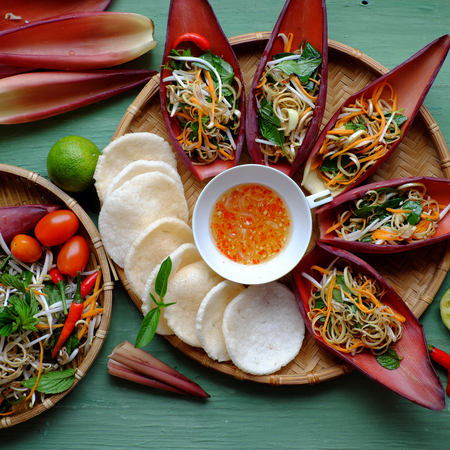 Vegetarian food from vegetable and banana flower, banana petal, carrot, peanut, bean sprouts, herbs mix with sauce to make diet salad and healthy eating
