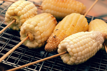 Home food for weekend, grilled corn on coal stove, a delicious, healthy snack food, hot corncob so nutrition