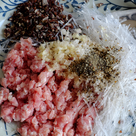 Raw material for Vietnamese egg roll or spring rolls or cha gio, is popular food at Vietnam cuisine, stuffing from meat and wrapper by rice paper
