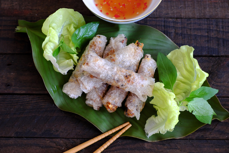 Vietnamese spring roll pastry or cha gio is popular food at Vietnam cuisine, stuffing from meat and wrapper by rice paper, then deep fried, eat with salad and fish sauce