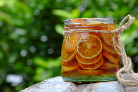 Organic medicine to remedy cough, pink lemon sliced soak with honey and sugar candy for a long time can make nature medicine in health care, a popular Vietnamese food Stock Photo