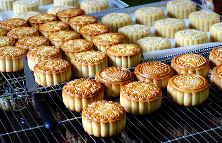 Doing moon cake for mid autumn festival at home, group of sweet cakes on tray, baking at home attractive many housewife that make food safety with delicious homemade product Archivio Fotografico