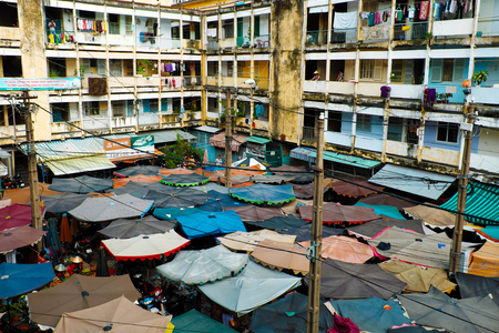 Amazing panoramic from high view of outdoor market among old building, open air market with group of parasol make impression scene on day, Vietnam