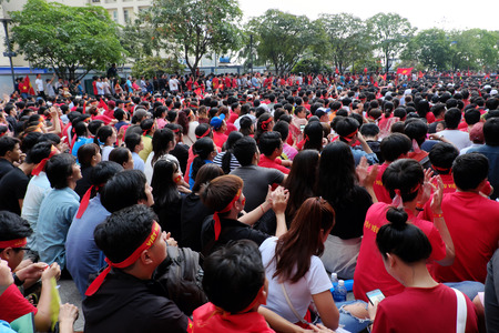 HO CHI MINH CITY, VIET NAM- JAN 27, 2018:  Amazing with large crowd of Vietnamese football supporters  watch AFC U23 soccer final match from outdoor Tv screen at Nguyen Hue walking street
