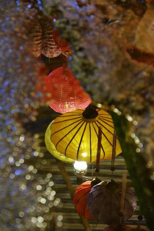 Lanterns reflect on surface water make lantern background with amazing bokeh lights